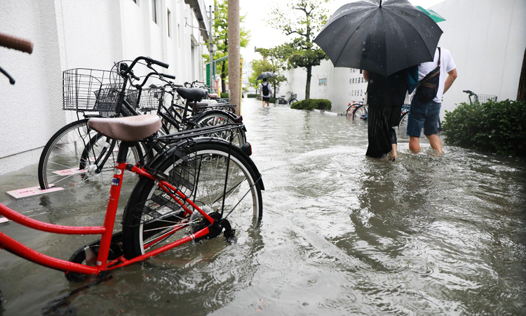Image result for Two dead as Japan orders 670,000 to flee heavy rains