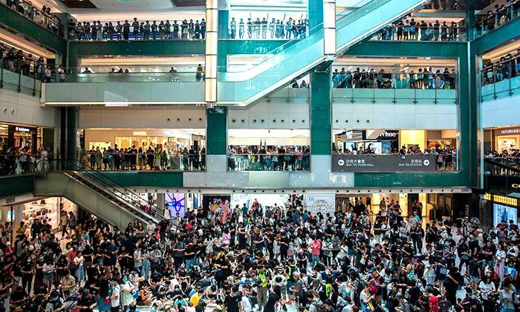 Hong Kong police storm mall after protesters smash rail station ...