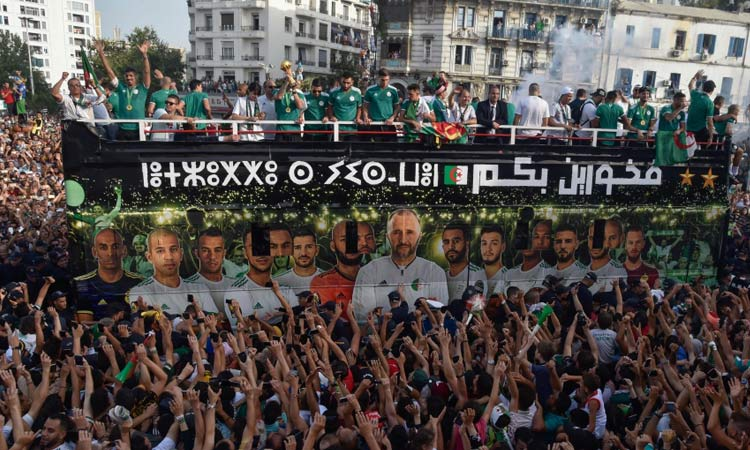 Tens of thousands of flag-waving and joyful Algerians welcome Africa Cup champions