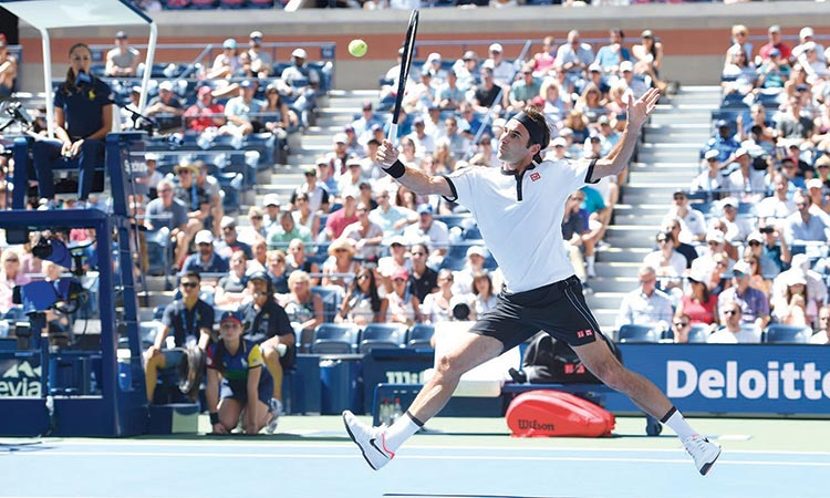 Federer storms into last 16,  Pliskova battles past Jabeur