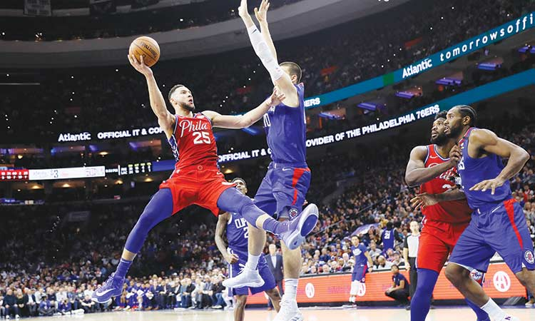 Simmons scores triple double  to power Sixers past Clippers